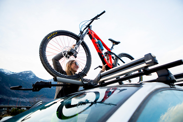 Biker loading roof rack in Whistler