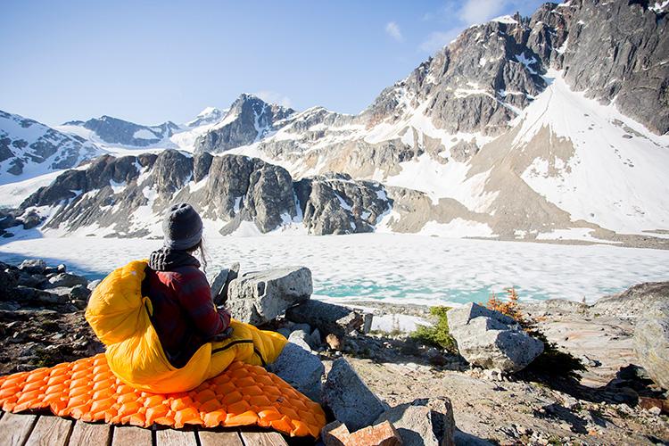 Camper in sleeping bag at Wedgemount Lake