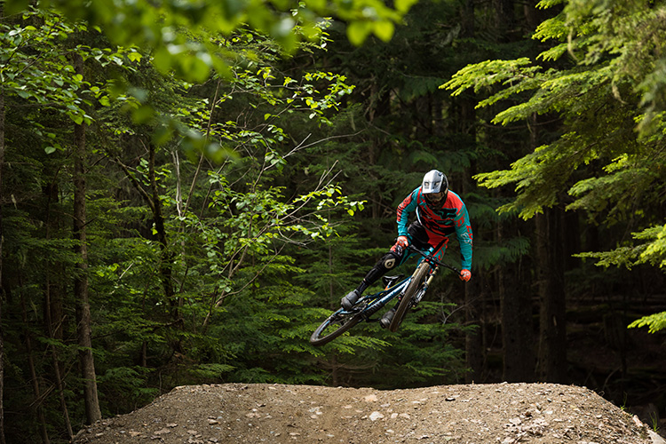 Rider doing a whip in the Whistler Mountain Bike Park