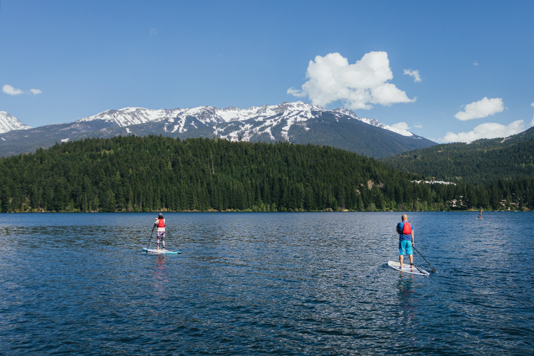 Guide and guest on a paddleboard tour in Whistler