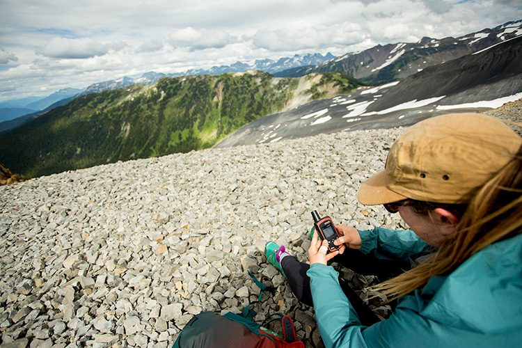 Hiker with satellite phone