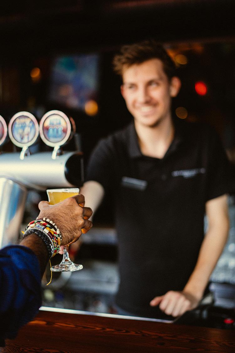 Highmontain Brewing bartender handing over a beer