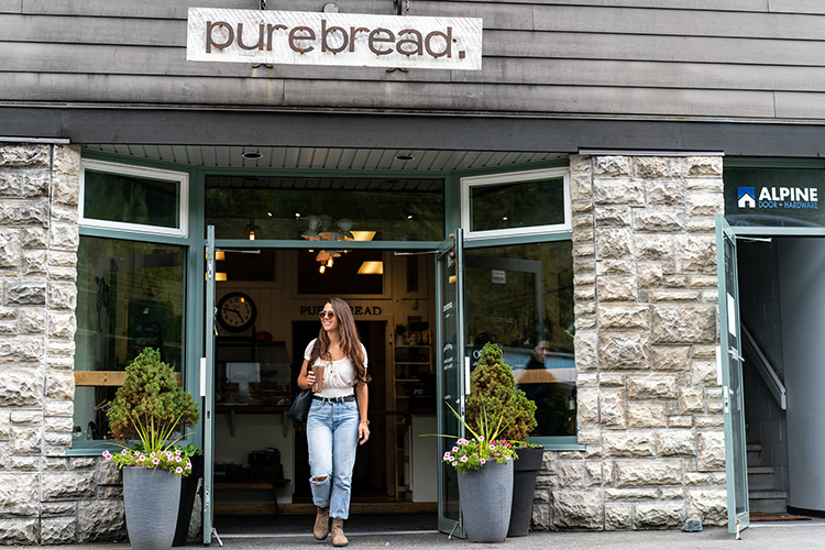 Shopper walking out of Purebread