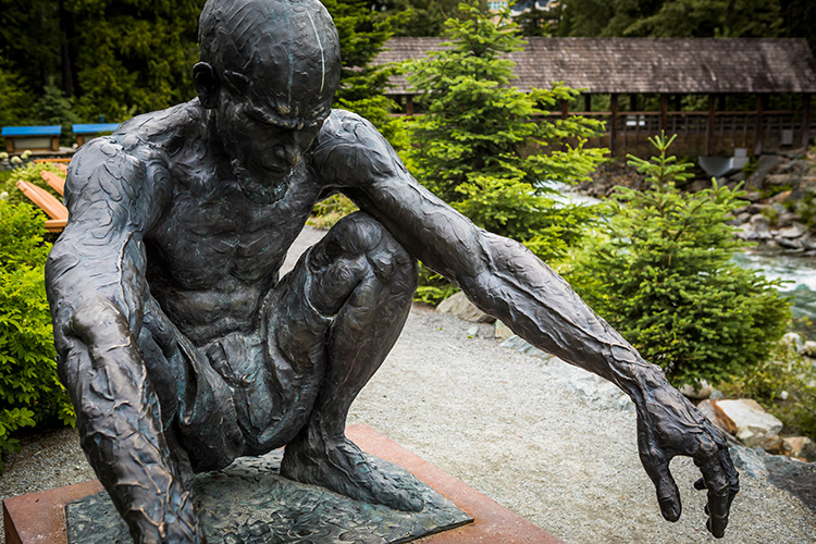 'Geri' a sculpture of a man crouching in Peace Park