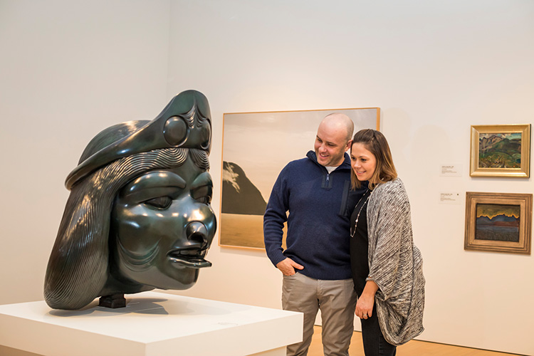 Couple looking at a sculpture at the Audain Art Museum