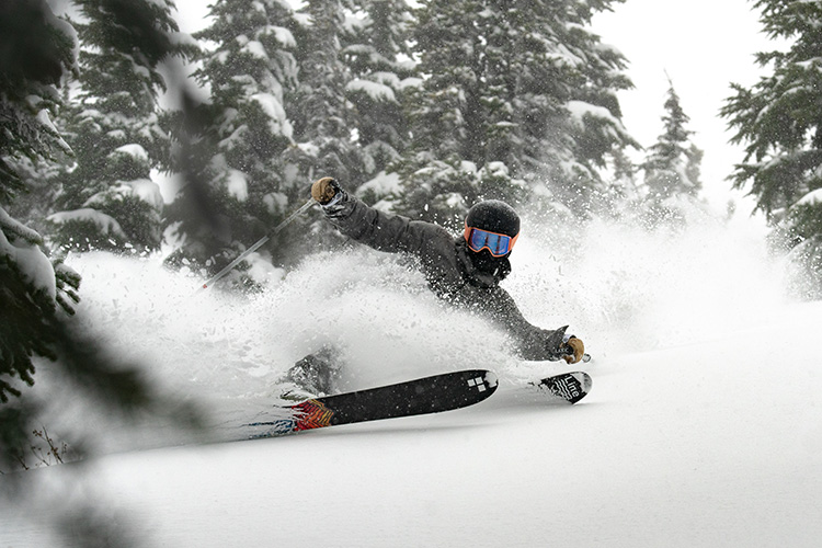 Skiier in powder conditions on Whistler Mountain