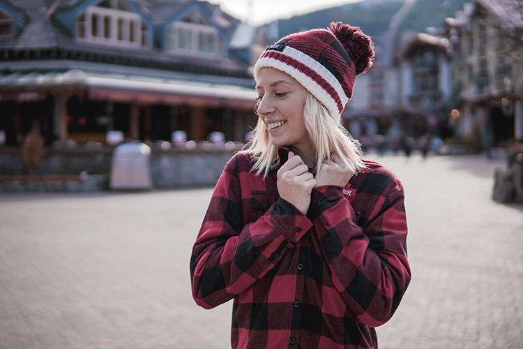 Woman wearing a plaid shirt in Whistler Village