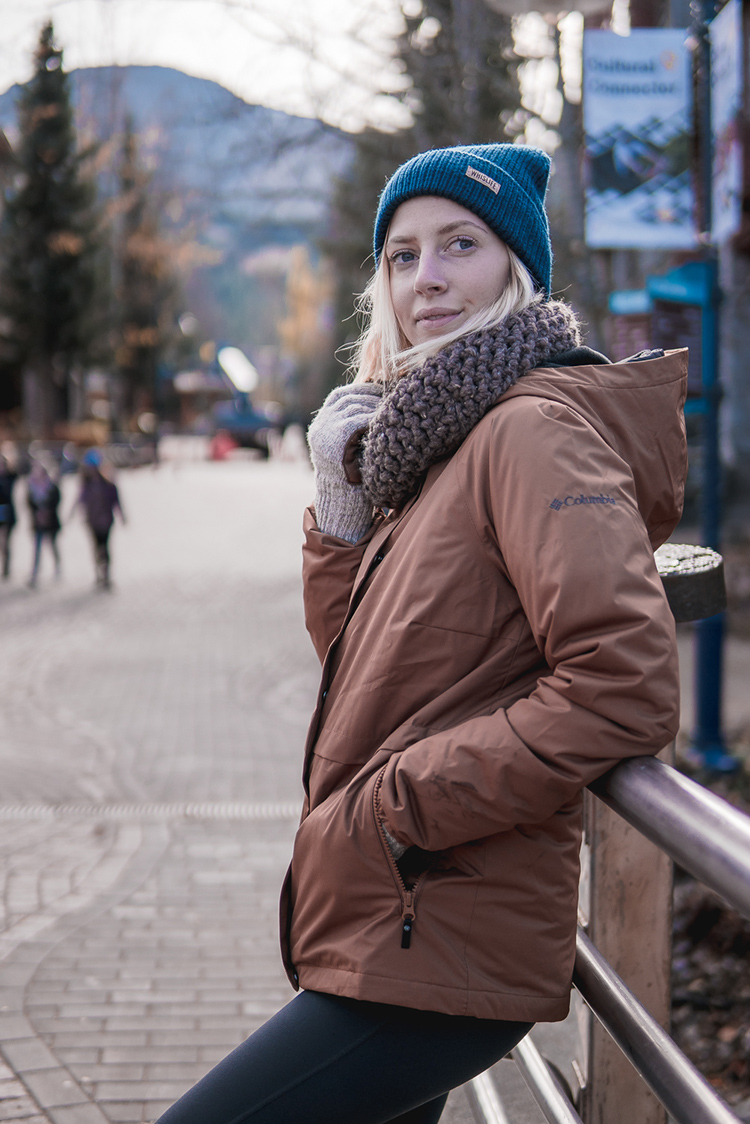 Woman dressed for winter in Whistler Village