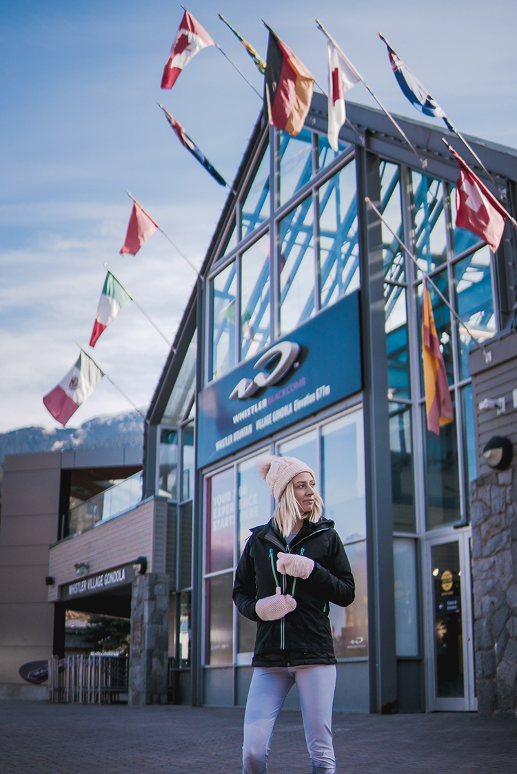 Women wearing a jacket standing in Whistler Village