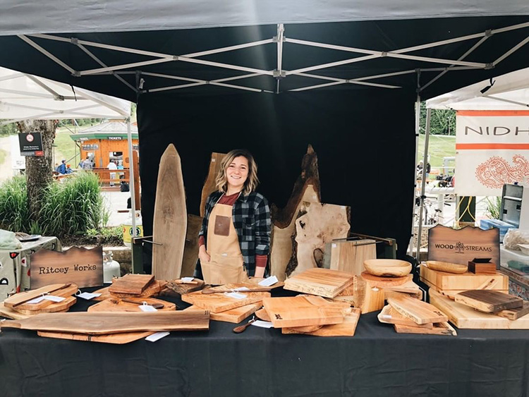 Wood cutting boards on display at the Whistler Farmers' Market