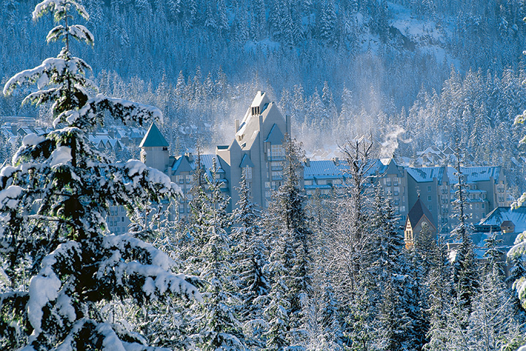 Fairmont Chateau in Whistler surrounded by snowy trees