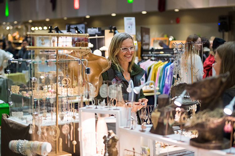 Shopper looking at jewellery at the Whistler Holiday Market