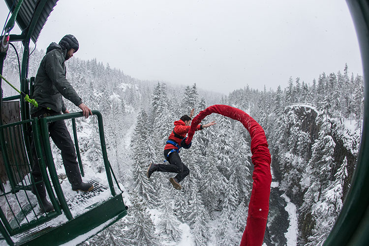 A man takes a leap off the bridge at Whistler Bungee.