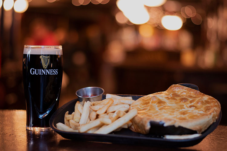 A pie with chips and a beer at the Dubh Linn Gate in Whistler.