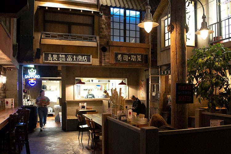 The inside at Ohyama Ramen looks like the streets of Tokyo.