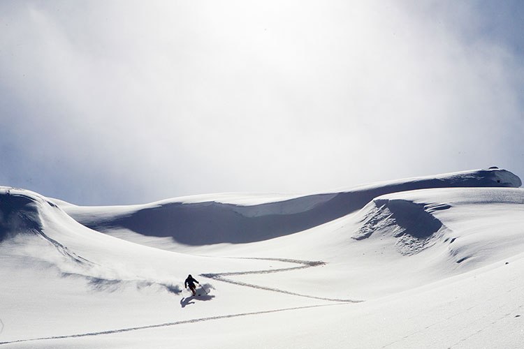 A backcountry skier descends the slope in Whistler