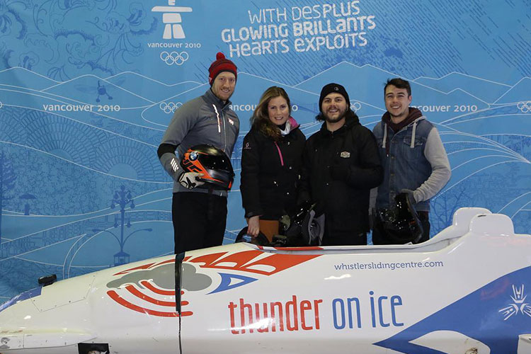 Kristen poses with her bobsleigh team at the Whistler Sliding Centre.
