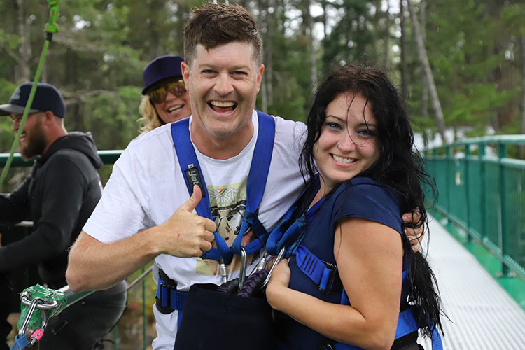 A couple smiles after leaping off the bridge at Whistler Bungee.