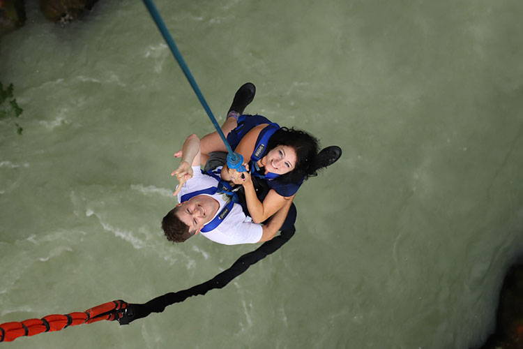 A couple look up after the initial jump at Whistler Bungee.