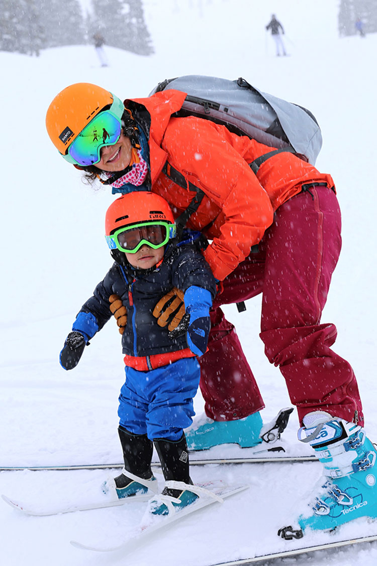 A toddler skis with his mum in Whistler.