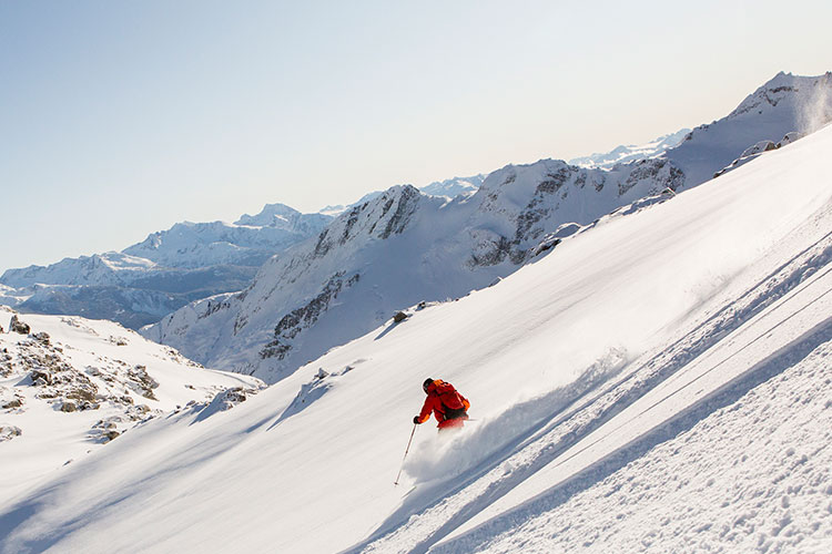 A skier tackles the powder with Whistler Heli-Skiing
