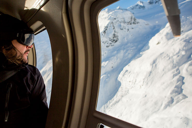 Mountain views from the inside of a helicopter in Whistler