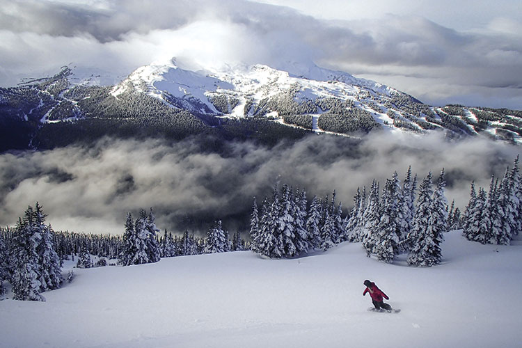 Snowboarder enjoying powder on cloud nine