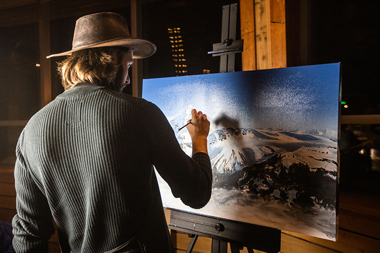 Artist Lucas Kratochwil paints in Whistler