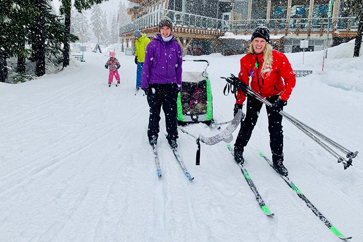 A family cross country skiing at Whistler Olympic Park.