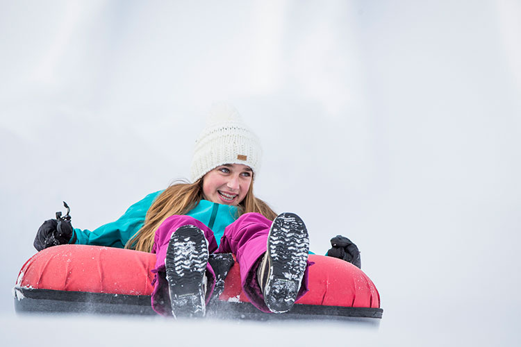 A teen at the tube park in Whistler.