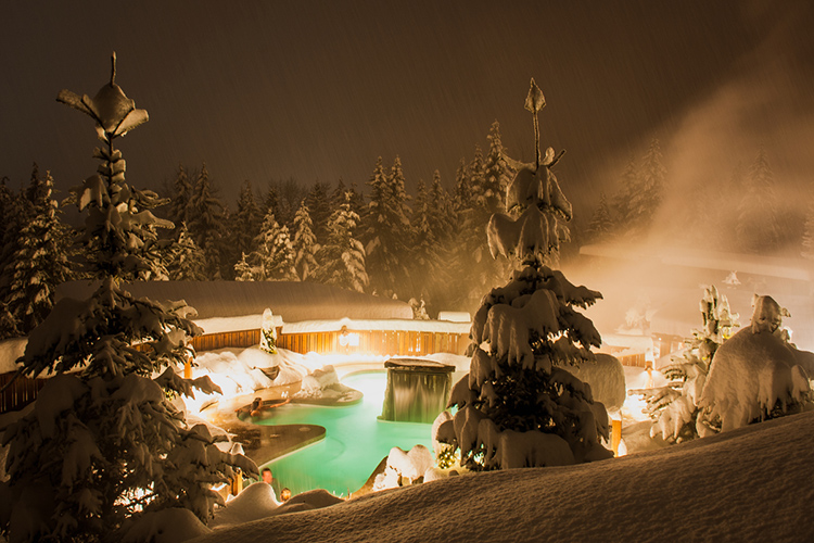 A snowy hot tub at the Scandinave Spa in Whistler