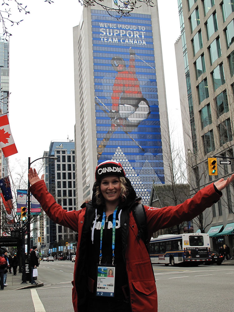 Kristi Richards in Vancouver next to a building wrapped with her image.