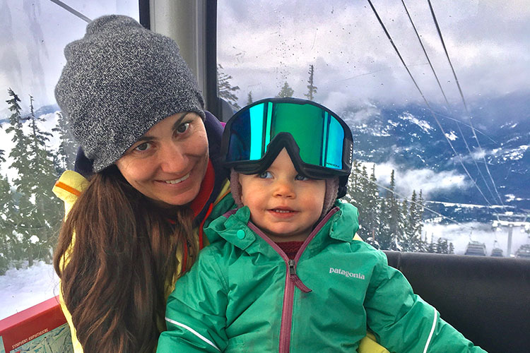 Olympian Maelle Ricker rides the Whistler Village Gondola with her baby girl.