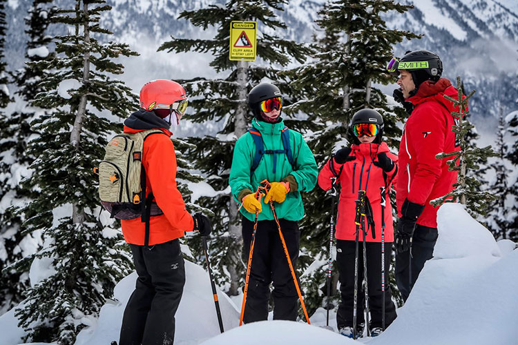 A mountain guide talks to teens on Whistler Blackcomb about safety in the backcountry.