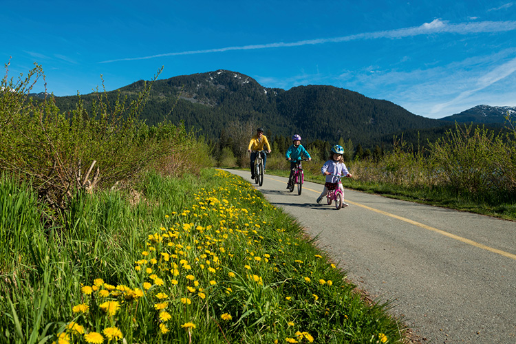 Family biking on the Valley Trail in Whistler