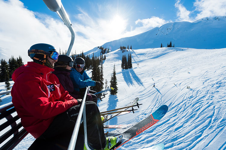 Three skiers ride a chairlift on Whistler Blackcomb and chat about their new run.