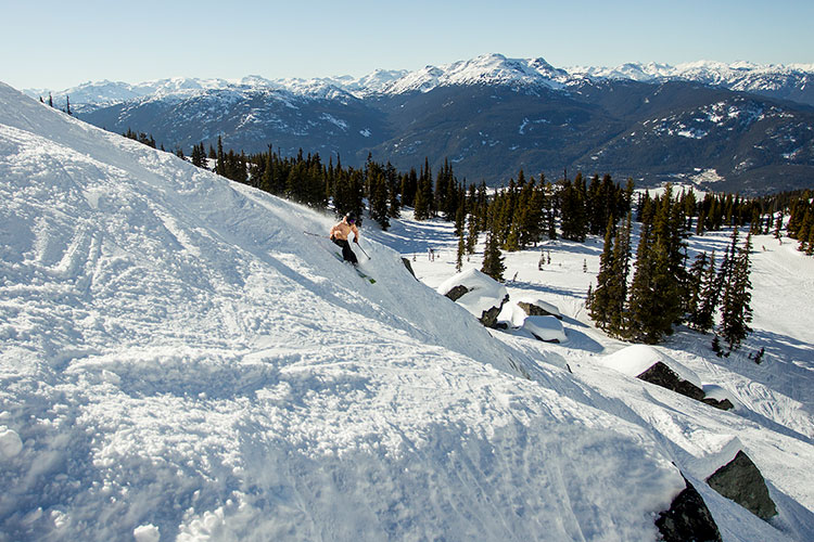 A skier tackles the bottom area of Secret Chute on Whistler Blackcomb.