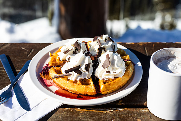 A Belgium waffle topped with cream, maple syrup and chocolate at the Crystal Hut on Whistler Blackcomb.