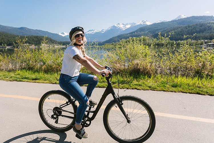 A woman bikes along the Valley Trail in Whistler.