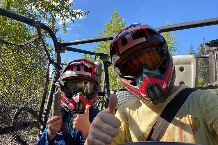 A father and son give their off-road mountain buggy tour the thumbs up in Whistler.