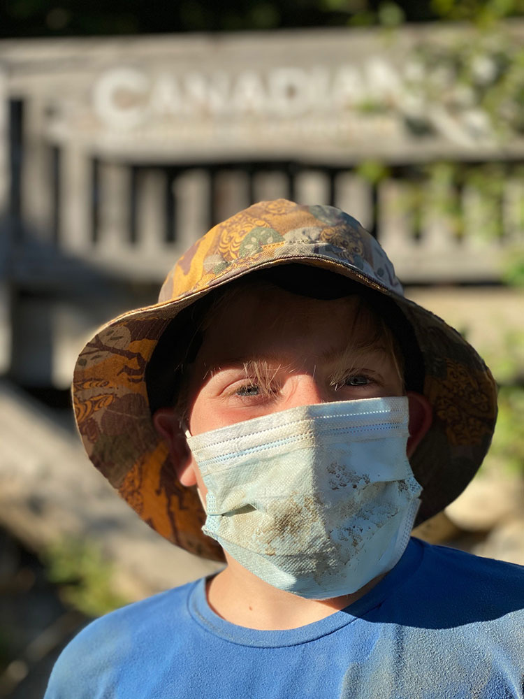 Henry looks at the camera with his face mask on after the mountain buggy tour.