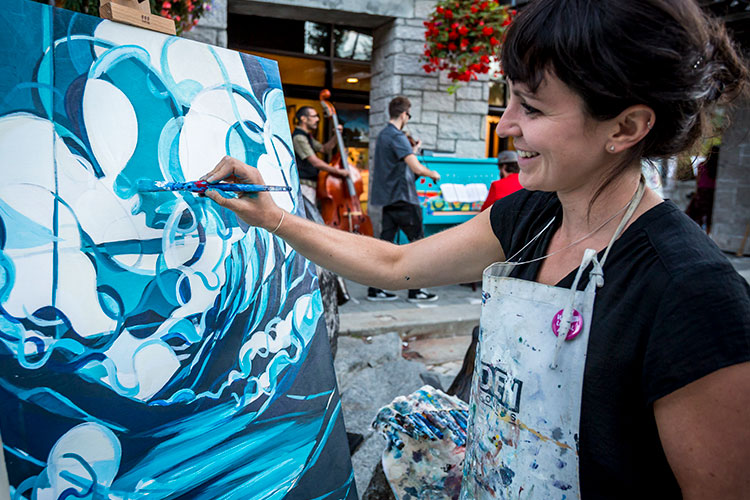 Whistler artist, Jessa Gilbert, paints at an art night in Whistler.