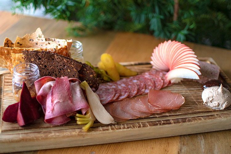 Alta Bistro's charcuterie board is a colourful display of meats, cheeses, fresh fruit and crackers.