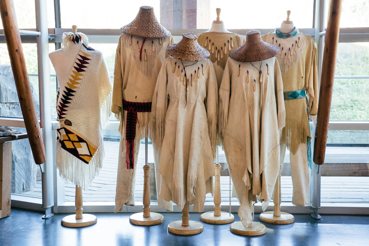 Six regalaia outfits on display at the Squamish Lil'wat Cultural Centre