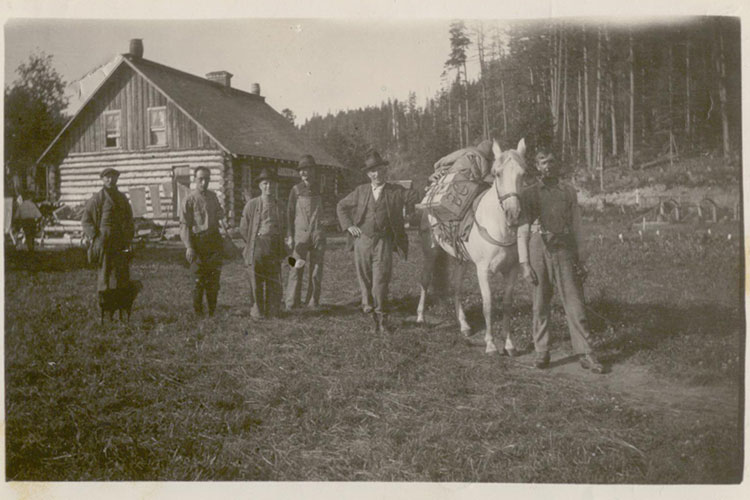 An archival photograph of a group of early Whistler settlers, including Bill Bailiff.