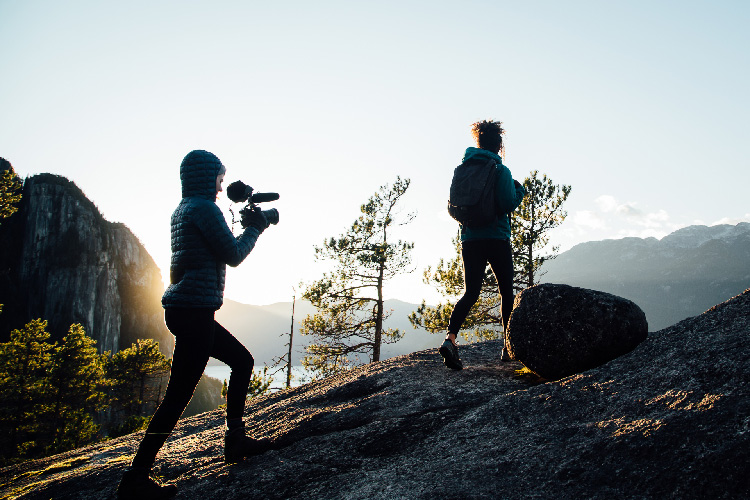 Women hiking and filming Nature Entwind