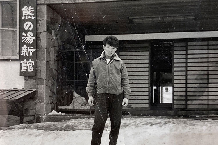 Toshi Hamazaki faces the camera for a black and white shot in Japan.