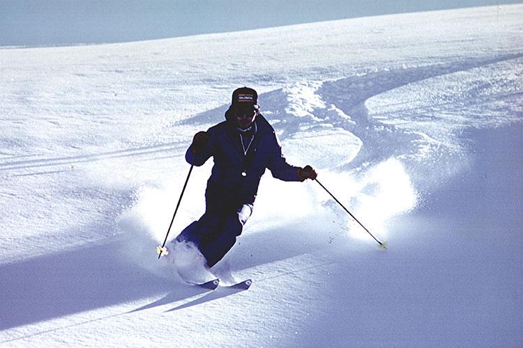 Toshi Hamazaki skiing down a slope in Whistler.