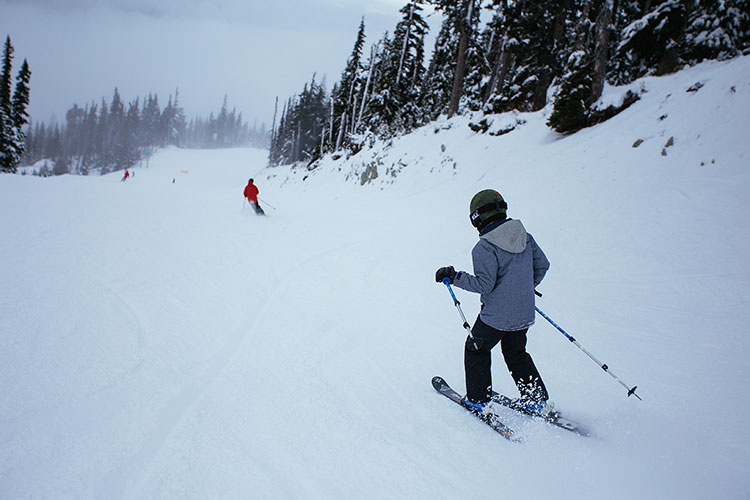 Father and son ski on Whistler Blackcomb's slopes on opening day.