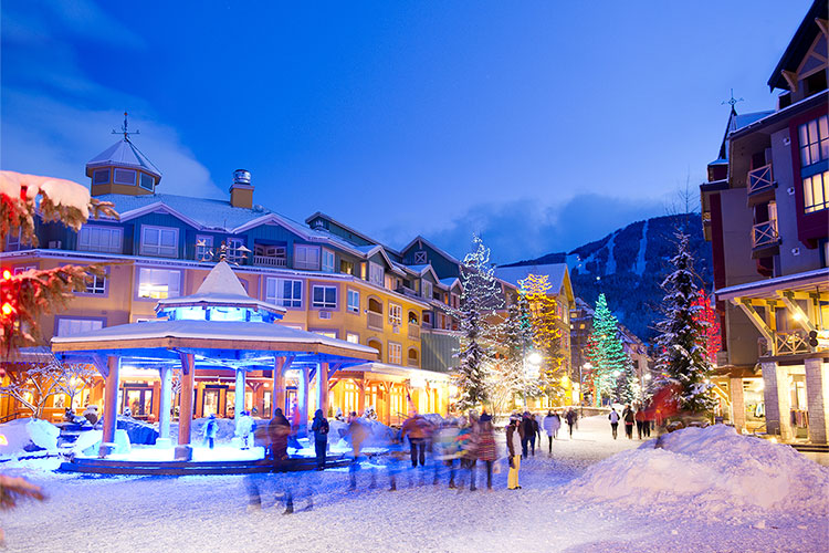 Whistler Village stroll in the winter with glowing festive lights.